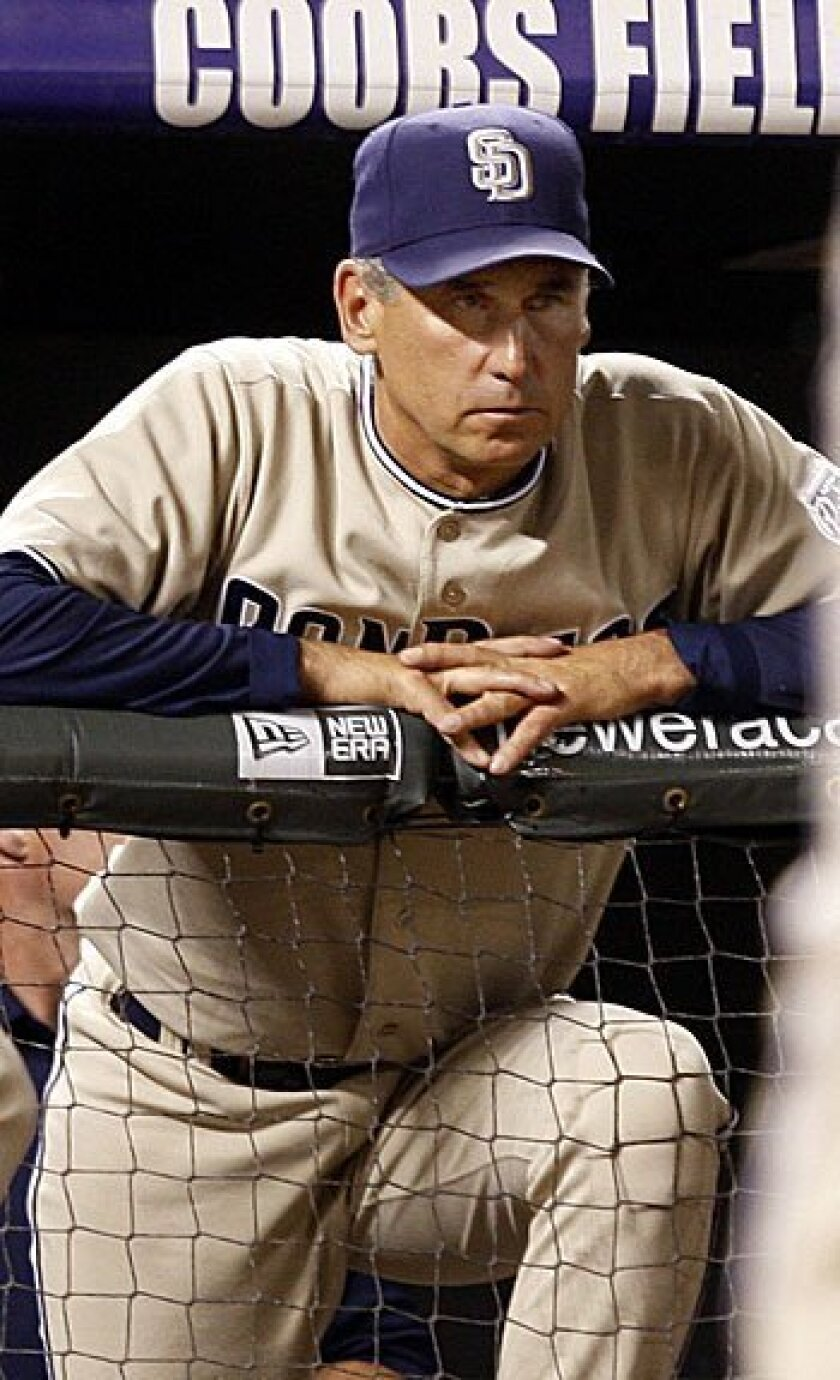 Padres manager Bud Black looks on as Edgar Gonzalez strikes out to Colorado Rockies starting pitcher Aaron Cook in the ninth inning of the Rockies' 4-0 victory in Denver Tuesday night.