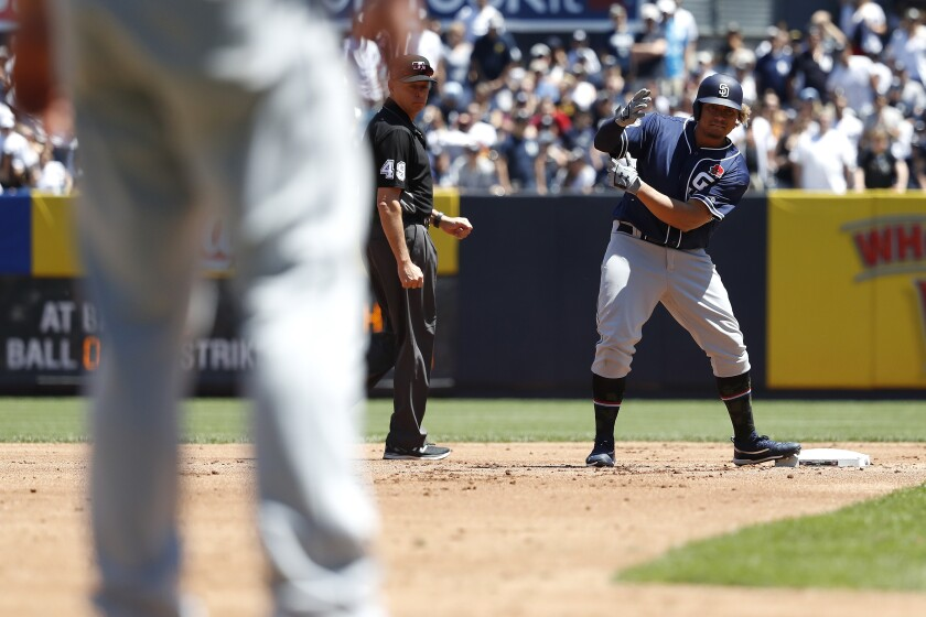 Josh Naylor, right, looks to the Padres dugout after hitting a double against the New York Yankees on Monday.