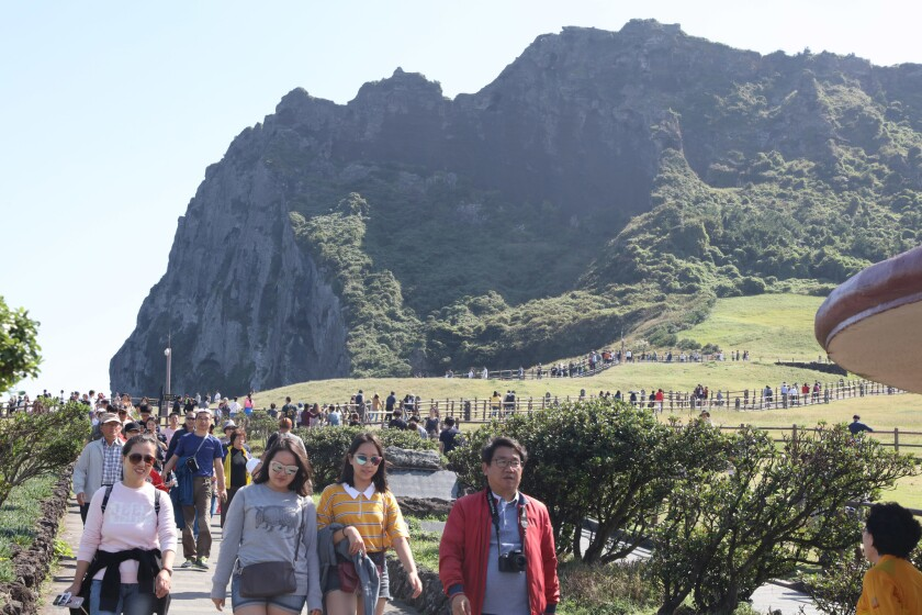 Tourists visit Jeju Island in South Korea. The island attracted about 1,200 visitors from China last year during the popular fall holiday known as Chuseok — down from roughly 8,800 visitors during the 2016 holiday.