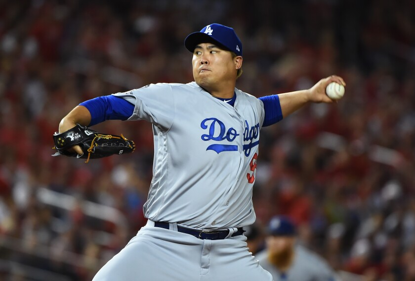 Dodgers starting pitcher Hyun-Jin Ryu delivers against the Nationals in the National League Division Series.
