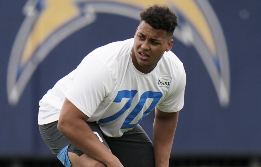 Chargers offensive tackle Rashawn Slater participates in a drill at practice.