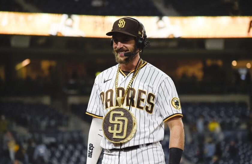 The Padres' Austin Nola wears a medallion