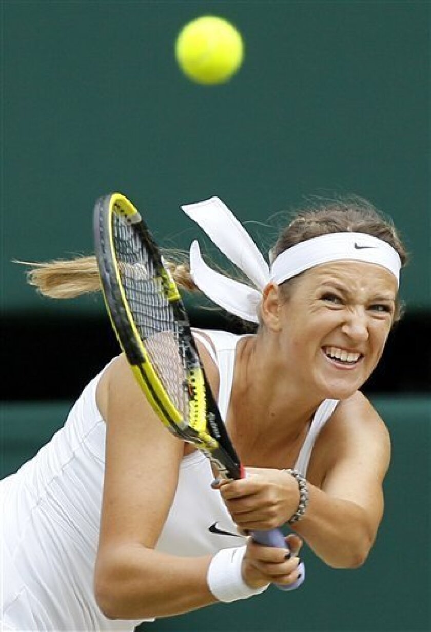 Victoria Azarenka of Belarus returns a ball during her semifinal match against Petra Kvitova of the Czech Republic at the All England Lawn Tennis Championships at Wimbledon, Thursday, June 30, 2011. (AP Photo/Kirsty Wigglesworth)