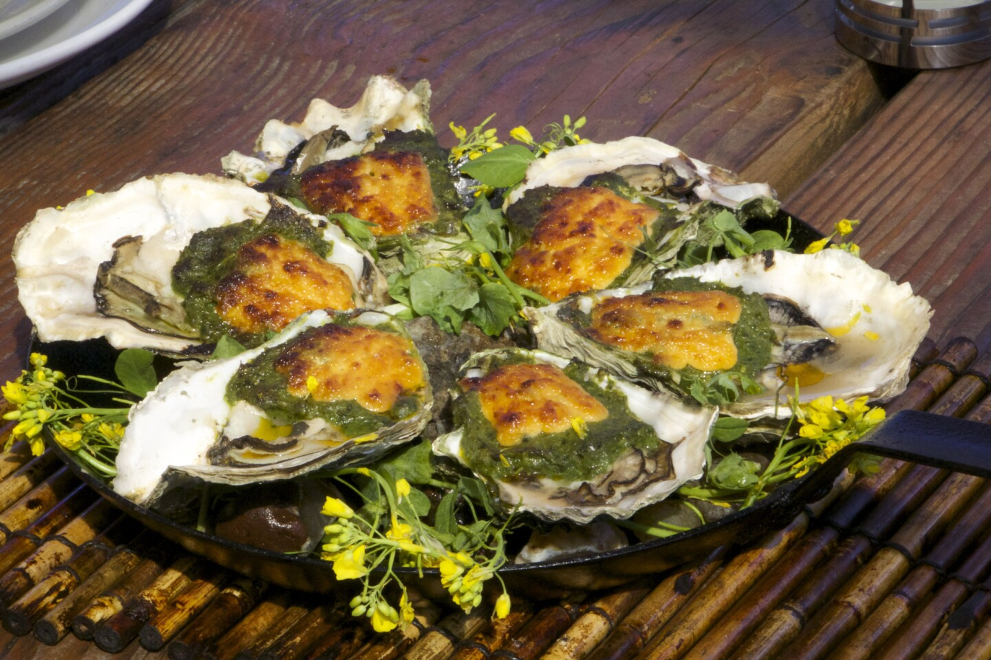 Local Oregon oysters, grilled with cheese and spinach from the Schooner in Tillamook, Ore.