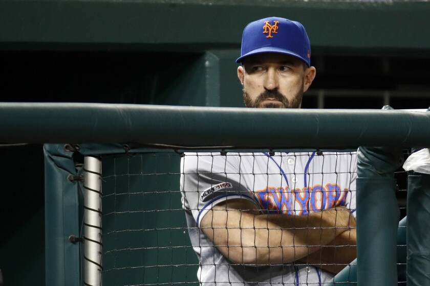 Mickey Callaway stands in the dugout in the eighth inning of a game between the New York Mets and the Washington Nationals on May 15.