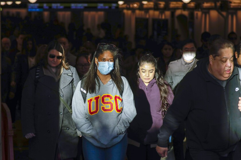 Some commuters at Union Station in downtown Los Angeles have opted to wear protective masks
