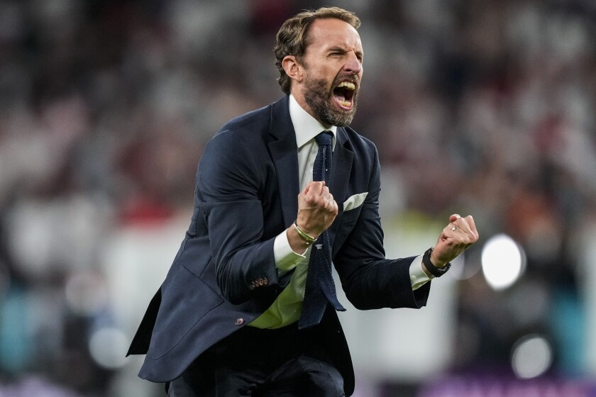 England's manager Gareth Southgate celebrates after winning the Euro 2020 soccer championship semifinal match against Denmark at Wembley stadium in London, Wednesday, July 7, 2021. (AP Photo/Frank Augstein, Pool)