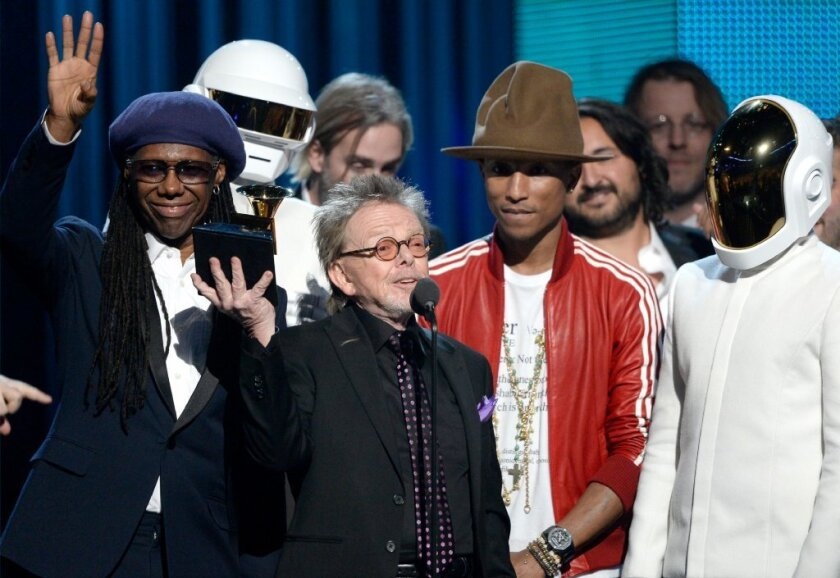 """Pharrell Willams, seen here with the Grammy Award-winning team for Daft Punk's """"Random Access Memories,"""" has put his hat up for auction."""