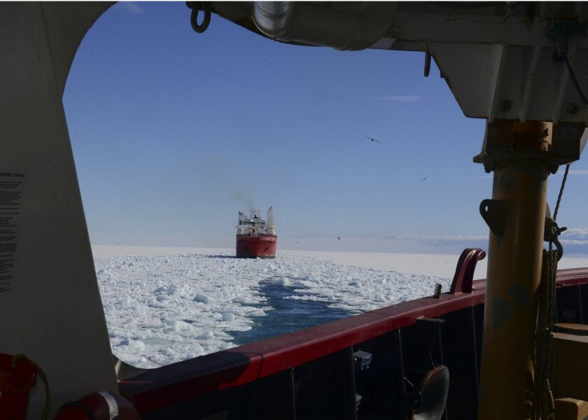 In this Jan. 26, 2015 photo, made available by the U.S. Coast Guard, the crew of the Coast Guard Cutter Polar Star opens a channel through the ice to the National Science Foundation's McMurdo Station, Antarctica, for the supply ship Ocean Giant. Solar Star's crew is aiding in the rescue of the Aust