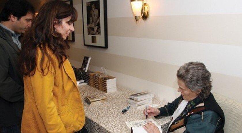 Dr. Temple Grandin signs a book for Niran Abbas. (Photo: Jon Clark)