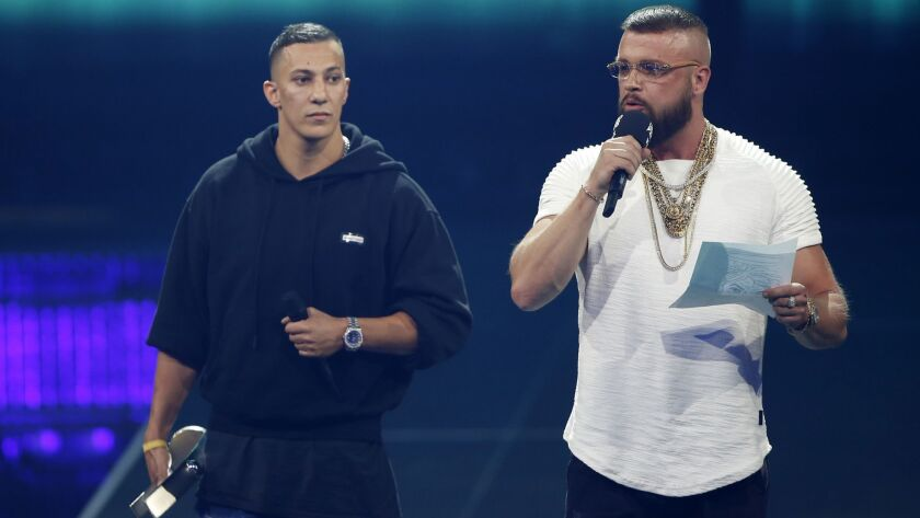 "In this April 12, 2018 photo German rappers Kollegah & Farid Bang receive the ""Hip-Hop/Urban nationa"