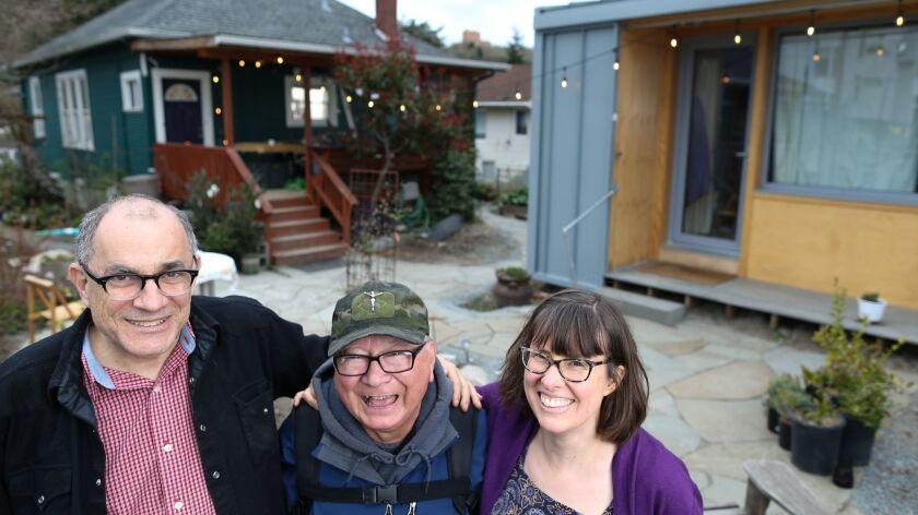 SEATTLE WA MARCH 30, 2018 -- Kim Sherman (right) and Dan Tenenbaum (left) visit with Robert Desjar