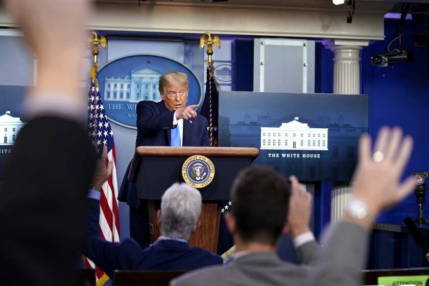 President Trump speaks during a news conference in the White House press briefing room Wednesday.