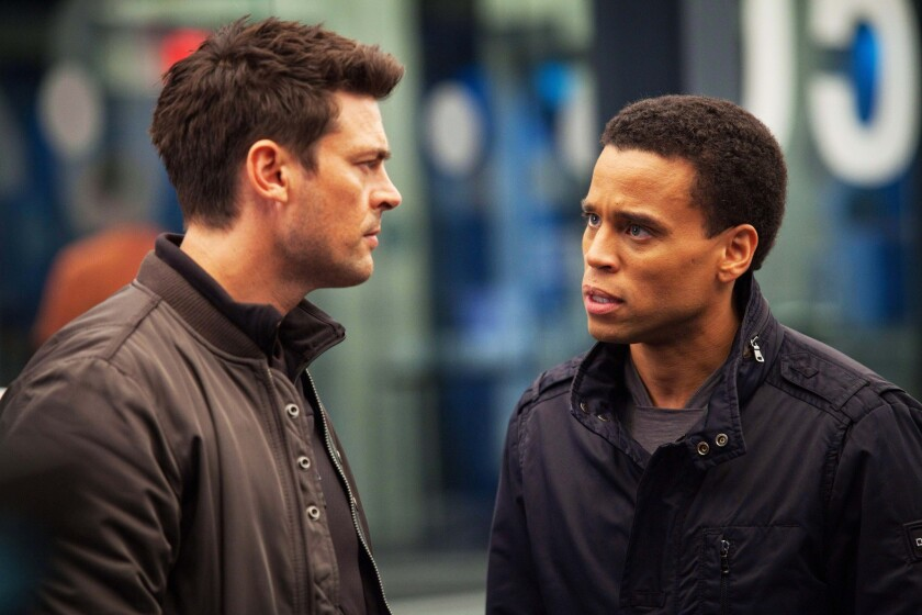 """Karl Urban, left, as John Kennex and Michael Ealy as Dorian partner to fight crime in the year 2048 in the new FOX drama, """"Almost Human,"""" premiering this fall on FOX."""