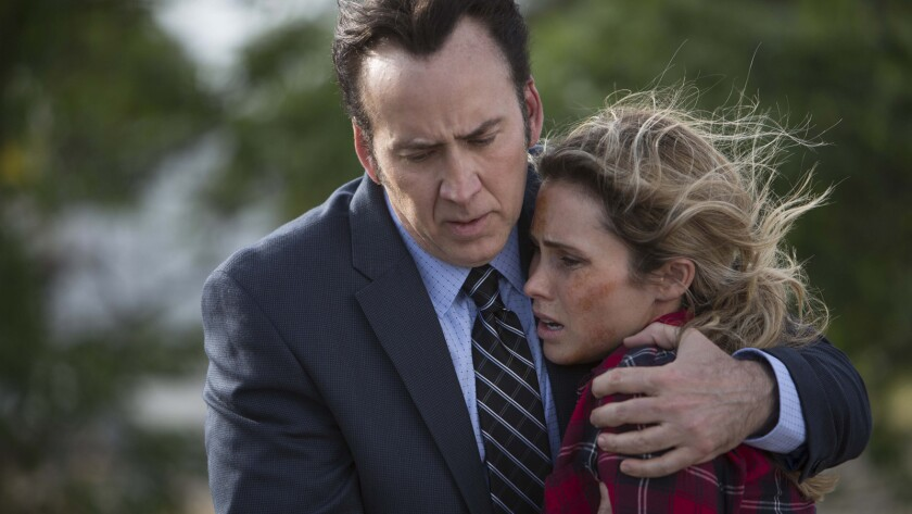 """Nicolas Cage and Anna Hutchison in the movie """"Vengeance: A Love Story."""""""