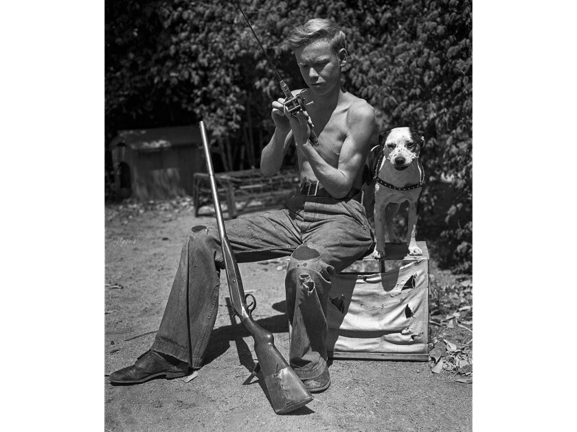 Robert Bly, 15, runaway, with his dog Don, after returning home to Eagle Rock. Bly and his dog spent three weeks hitchhiking around California. This photo appeared in the Aug. 13, 1935, Los Angeles Times. The image is from the Los Angeles Times Archive at UCLA.