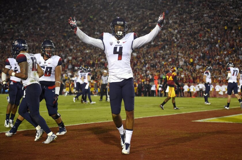 Arizona wide receiver David Richards celebrates after making a touchdown catch during the first half of an NCAA college football game against Southern California, Saturday, Nov. 7, 2015, in Los Angeles. (AP Photo/Mark J. Terrill)