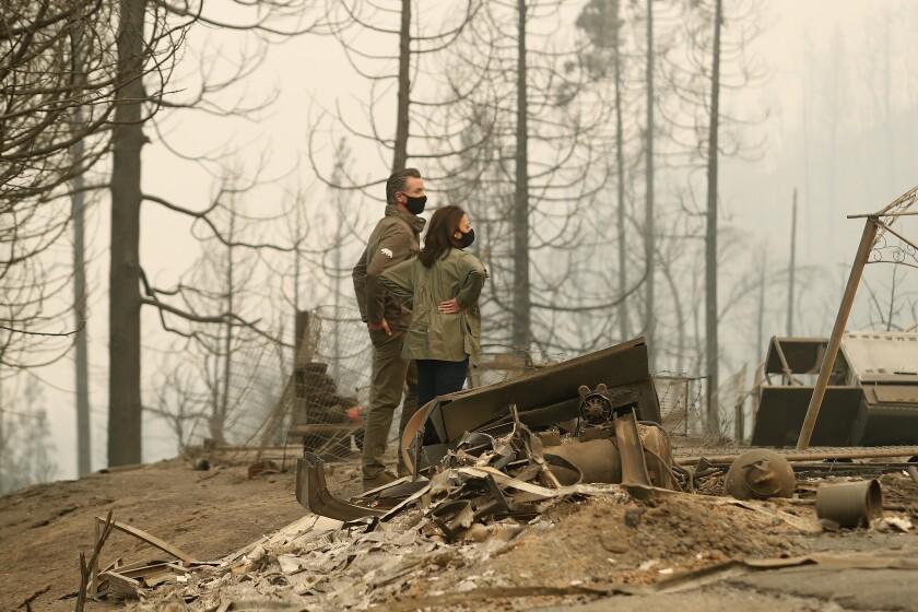 California Gov. Gavin Newsom and Democratic vice presidential candidate Sen. Kamala Harris, D-Calif., talk as they asses the damage during the Creek Fire at Pine Ridge Elementary, Tuesday, Sept. 15, 2020, in Auberry, Calif. (AP Photo/Gary Kazanjian)