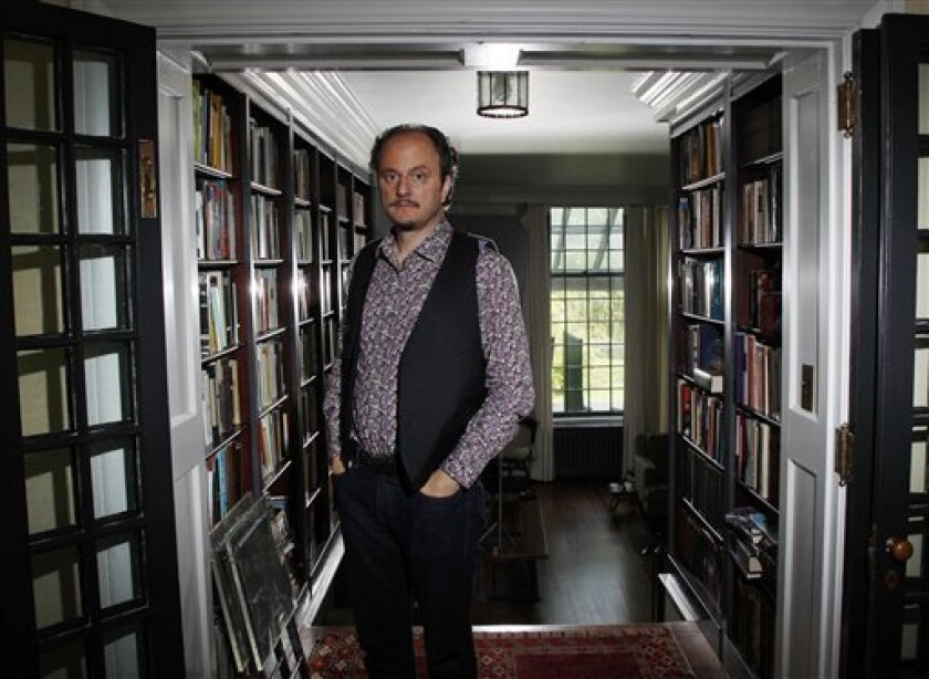 "In this Sept. 26, 2011 photo, Pulitzer Prize-winning author Jeffrey Eugenides poses at his home in Princeton, N.J. The 51-year-old author is a Pulitzer Prize winner, Oprah Winfrey book club pick and author of one of this fall's most anticipated novels, ""The Marriage Plot."" (AP Photo/Mel Evans)"