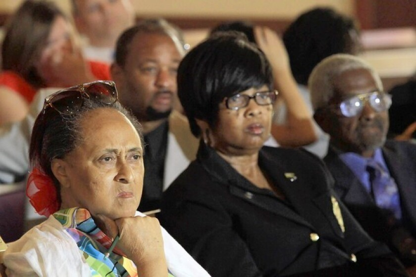 Audience members listen attentively at a mayoral candidates' forum at Brookins Community AME Church in South L.A. on Saturday.