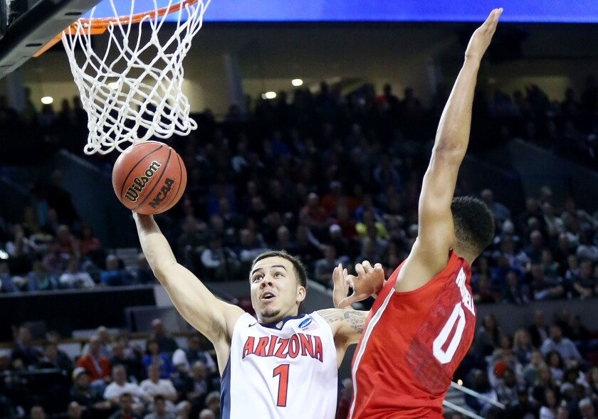 Arizona guard Gabe York goes up against Ohio State point guard D'Angelo Russell during the second half of their third-round matchup in the NCAA tournament.