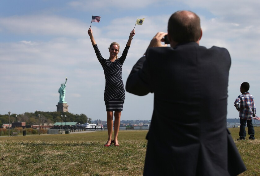 Immigrants become U.S. citizens