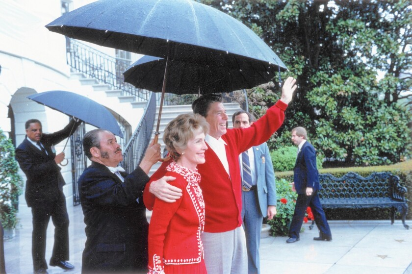 President Reagan and First Lady Nancy Reagan wave to supporters after leaving George Washington University Hospital in 1981.