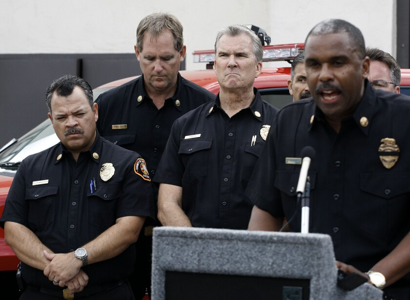 L.A. County Fire Chief Daryl Osby, right, talks about Kevin Woyjeck during a news conference last week.