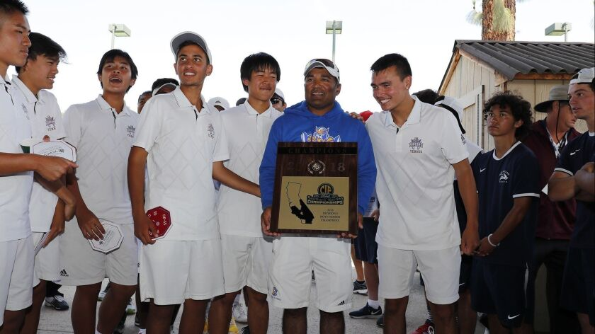 Fountain Valley High boys' tennis head coach Harshul Patel holds the championship plaque after the B