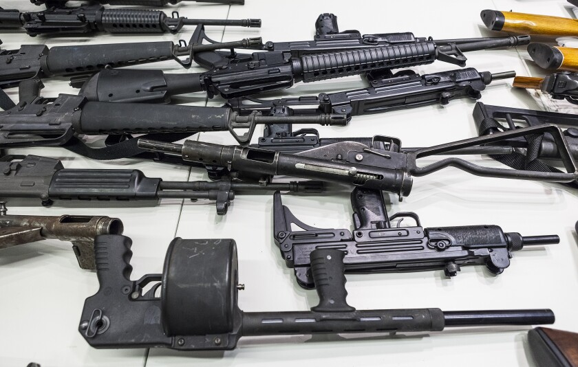 Weapons that include handguns, rifles, shotguns and assault weapons, collected in a gun buyback event.