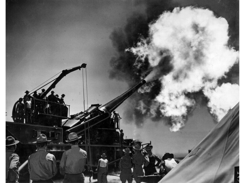 June 12, 1936: A United States Army Coast Defense 14-inch railway gun is fired during target practice near Oceanside, Calif.