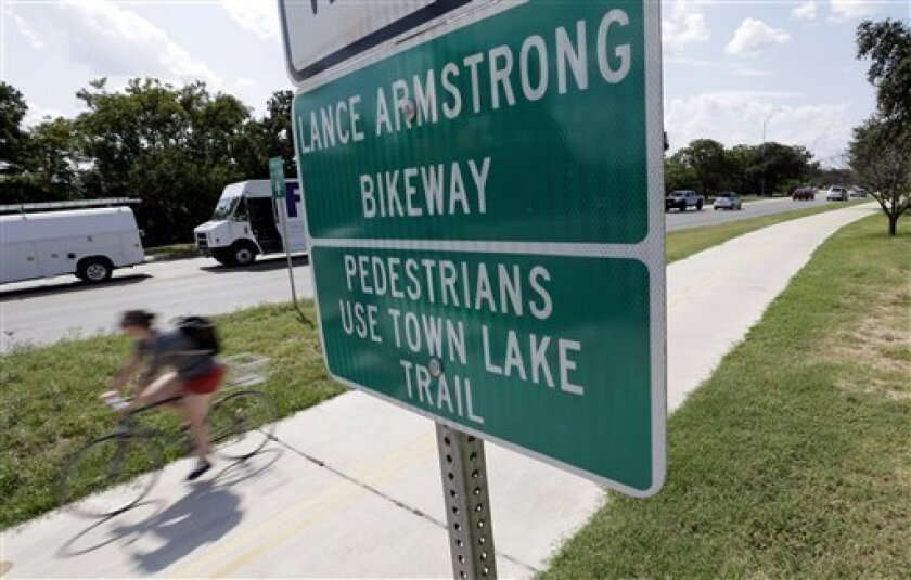A cyclist rides along the Lance Armstrong Bikeway, Friday, Aug. 24, 2012, in Austin, Texas. The U.S. Anti-Doping Agency stripped Armstrong's seven Tour de France titles Friday, erasing one of the most incredible achievements in sports after deciding he had used performance-enhancing drugs to do it.