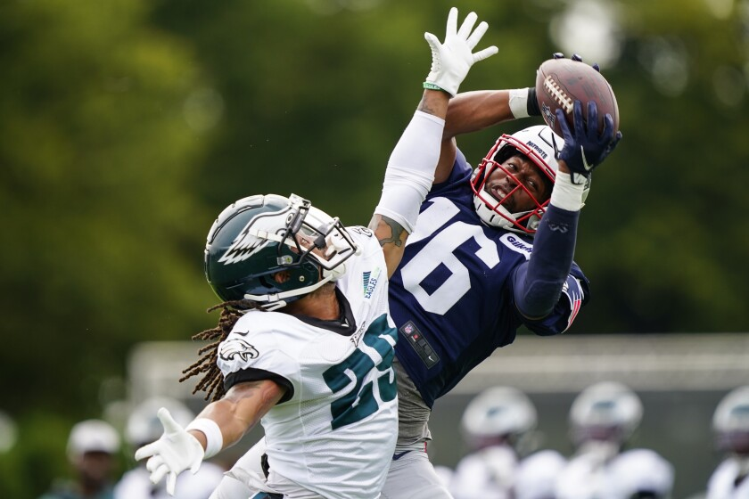 New England Patriots wide receiver Jakobi Meyers, right, catches a pass over Philadelphia Eagles free safety Avonte Maddox during a joint practice at the Eagles NFL football training camp Monday, Aug. 16, 2021, in Philadelphia, (AP Photo/Matt Rourke)