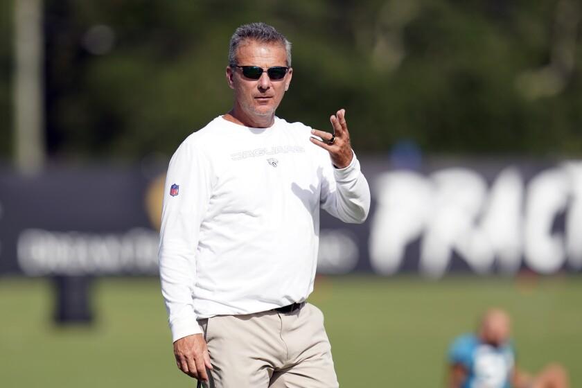 Jacksonville Jaguars head coach Urban Meyer gestures during NFL football practice, Friday, Aug. 6, 2021, in Jacksonville, Fla. (AP Photo/John Raoux)