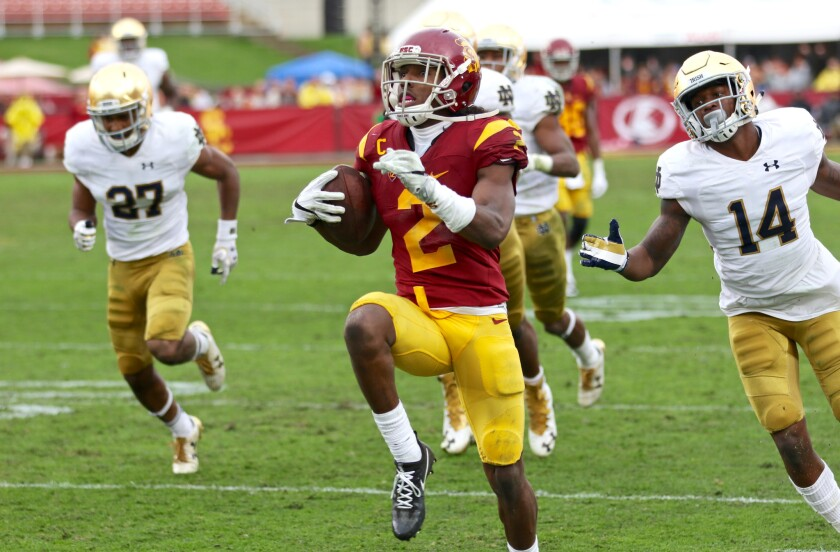 USC's Adoree' Jackson runs away from Notre Dame defenders on a 52-yard touchdown reception on Nov. 26.