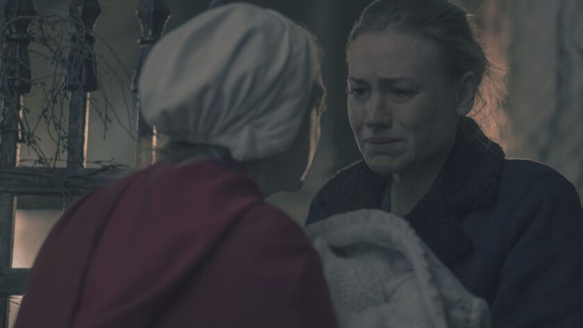 """Elisabeth Moss as June and Yvonne Strahovski as Serena Joy in a scene from """"The Handmaid's Tale."""""""
