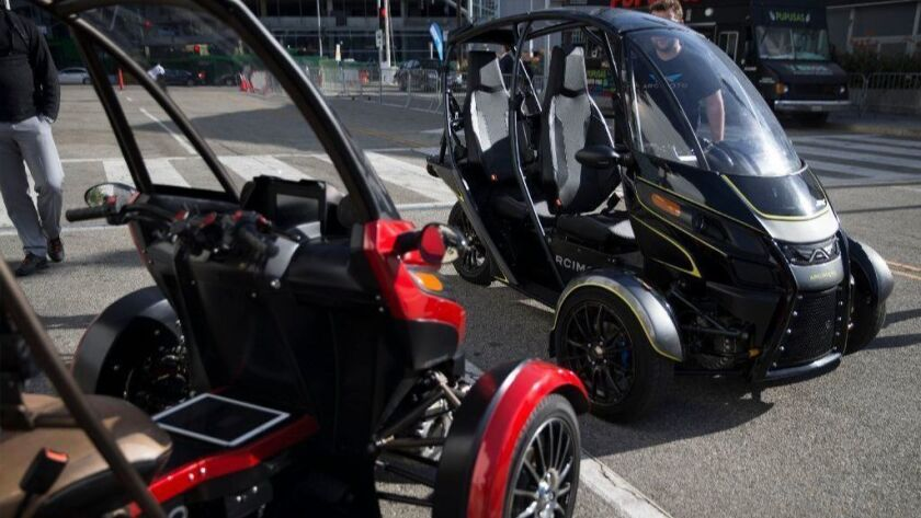 """The Arcimoto SRK, a tandem two-seat, three-wheeled electric vehicle, was available for test-driving at """"Automobility,"""" the 2017 L.A. Auto Show at the L.A. Convention Center."""