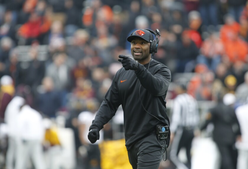 Cory Hall gestures along the sideline as interim coach for Oregon State.