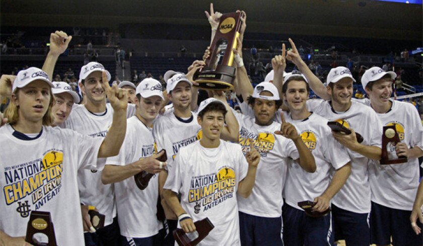UC Irvine players celebrate after winning the team's second straight NCAA volleyball title with a 25-23, 25-22, 26-24 victory over BYU at Pauley Pavilion on Saturday.