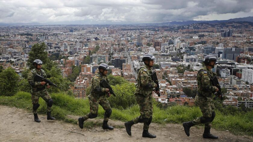 Soldiers patrol the outskirts of Bogota, Colombia, as part of pre-electoral security, Saturday, May