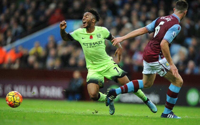 Manchester City's Raheem Sterling, left, is tackled by Aston Villa's Ciaran Clark during the English Premier League soccer match between Aston Villa and Manchester City at the Villa Park, Birmingham, England, Sunday, Nov. 8, 2015. (AP Photo/Rui Vieira)