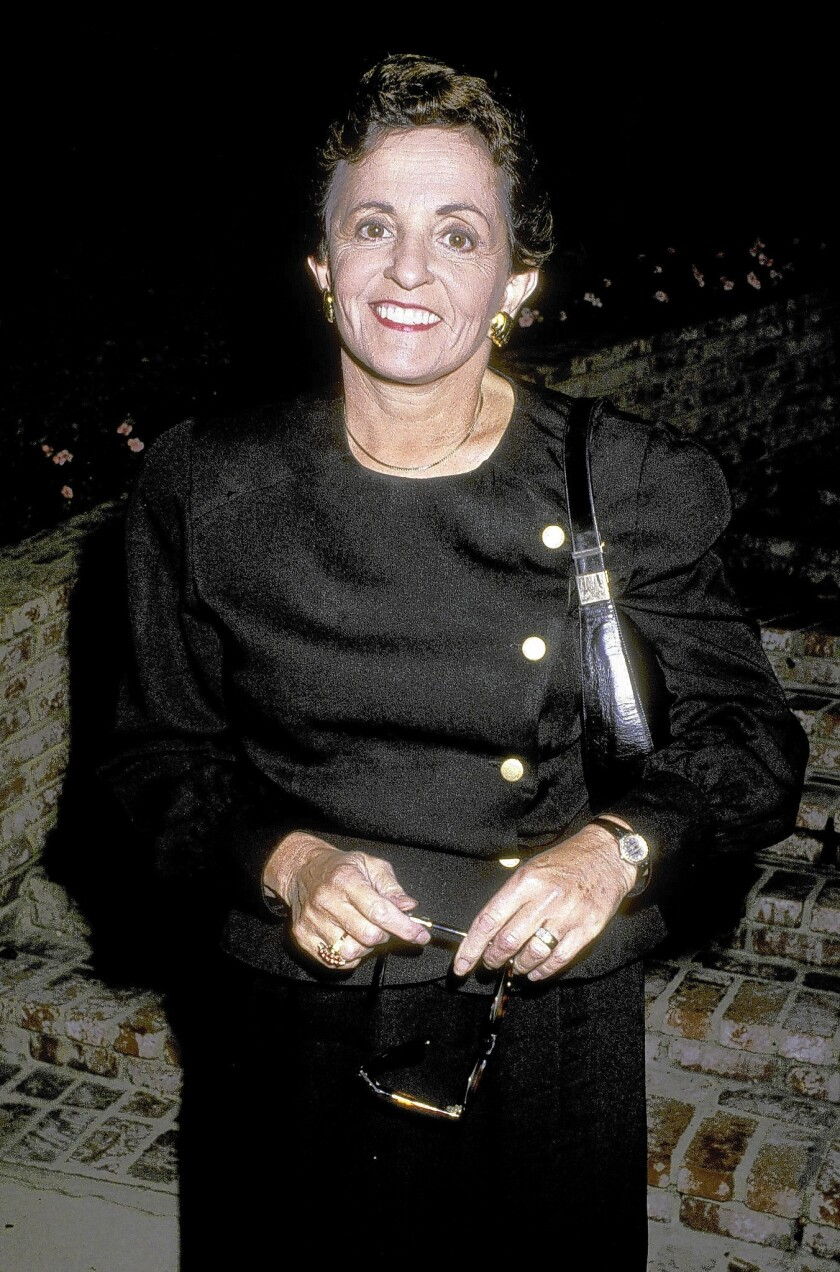 Syndicated Hollywood columnist Marilyn Beck, shown here at a party in Beverly Hills in 1988, cast herself as a reporter rather than a gossip columnist.