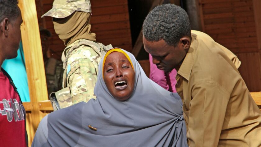 A mother grieves in Mogadishu, Somalia, for her daughter, who was shot in the head during a militant attack on a restaurant.