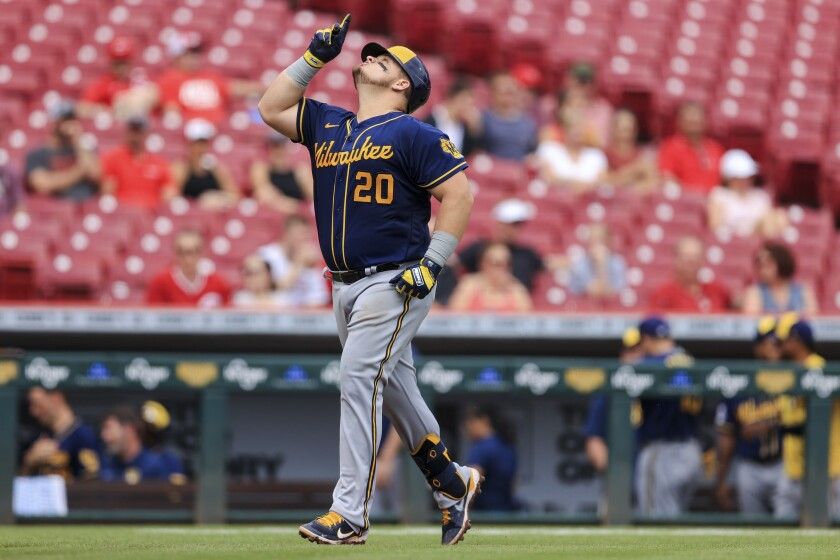 Milwaukee Brewers' Daniel Vogelbach reacts as he runs the bases after hitting a two-run home run during the seventh inning of a baseball game against the Cincinnati Reds in Cincinnati, Thursday, June 10, 2021. (AP Photo/Aaron Doster)