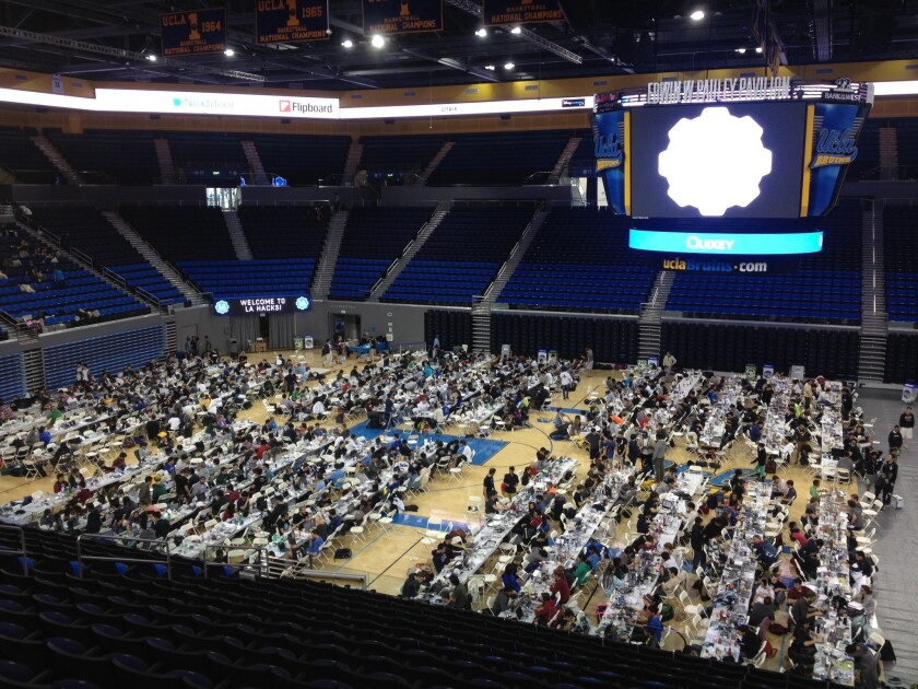 College students pack onto the floor of UCLA's Pauley Pavilion for the the LA Hacks hackathon.