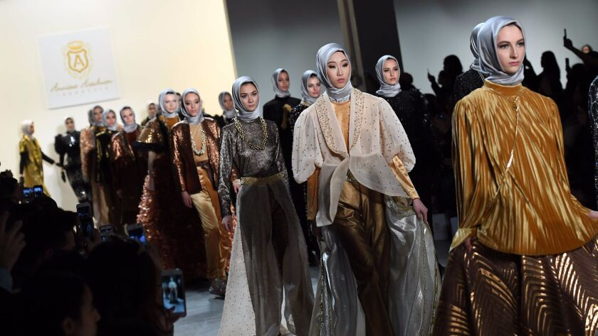 Models walk the runway for the Anniesa Hasibuan show during New York Fashion Week in New York City on Feb. 14.
