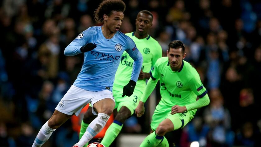 Manchester City's Leroy Sane, left, in action during the UEFA Champions League round of 16 second leg match between Manchester City and FC Schalke 04 on Saturday.