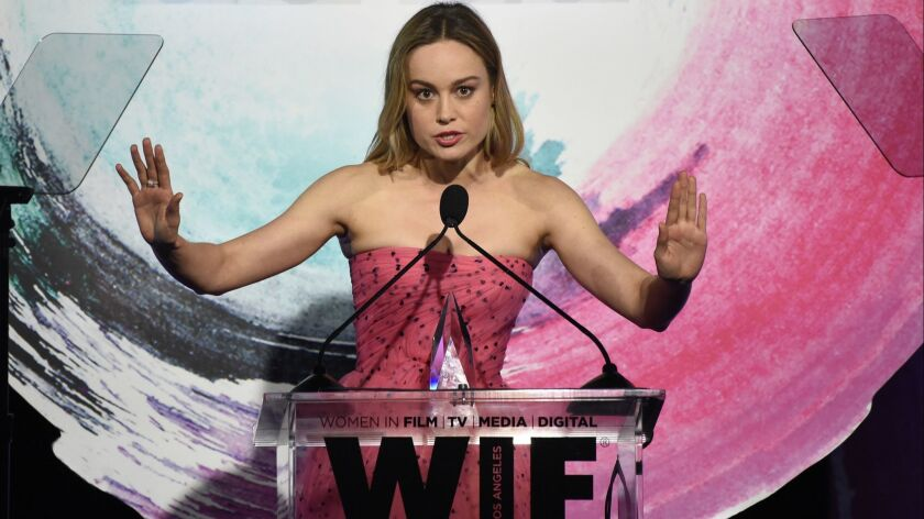 Brie Larson accepts the Crystal award for excellence in film at the Women in Film Crystal + Lucy Awards.