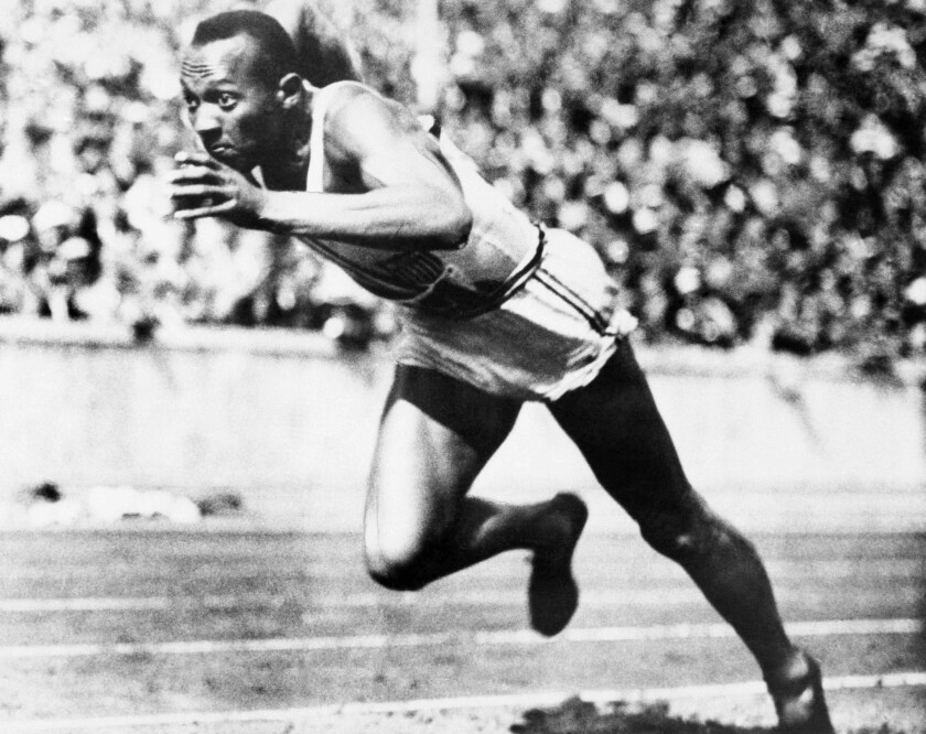 Jesse Owens competes in the 1936 Olympic Games in Berlin.