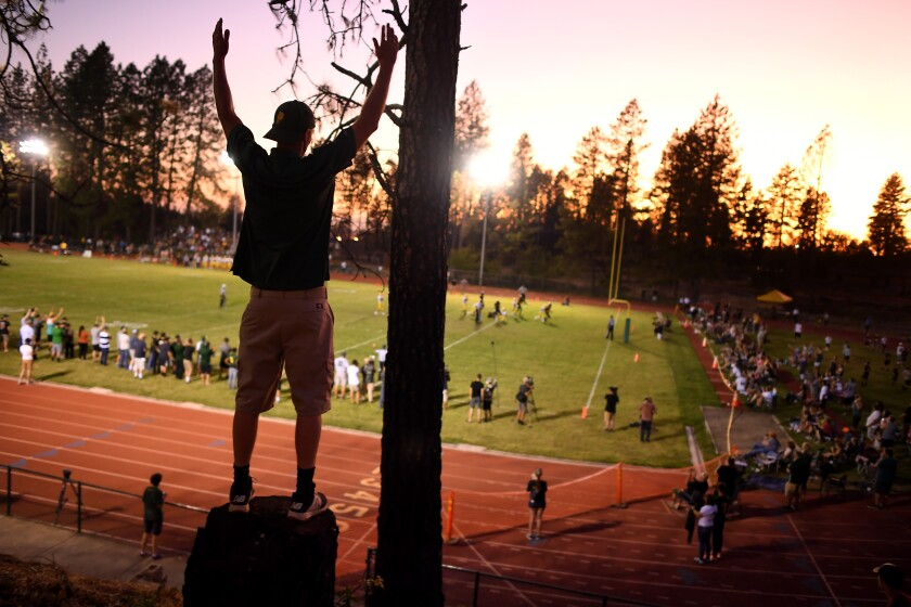 A fan celebrates Paradise's first touchdown of the season.